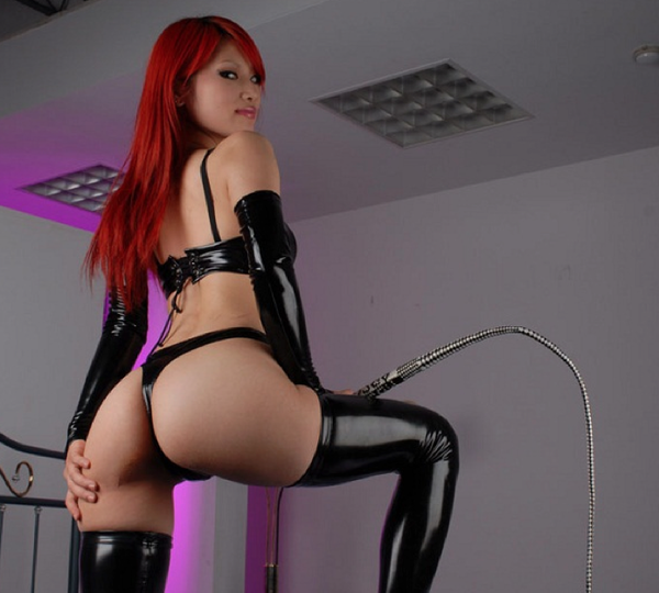 Japanese domme in latex punishes her male slave 6